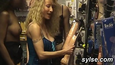 3 MILFs sharing anal orgy in shop with..