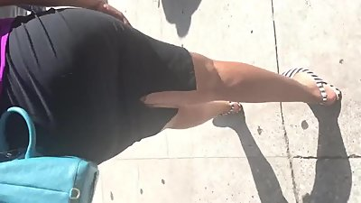 Tall Big booty MILF in tight black dress
