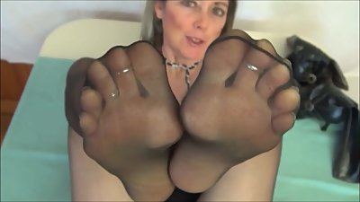 Mature lady in black pantyhosed feet..