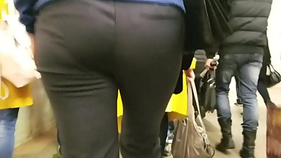 MILF's ass in black pants in once..