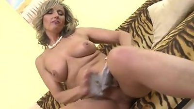Horny blonde lady masturbating on couch