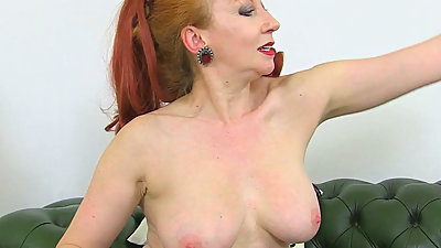 English milf Red teases us with her..